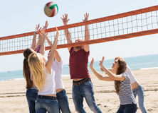 Friends playing volleyball at beach Royalty Free Stock Photography