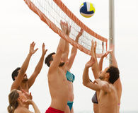 Friends playing volleyball at beach Royalty Free Stock Photo