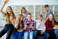 Friends playing an xbox. Group of friends playing an xbox game Stock Photo