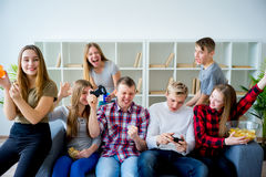 Friends playing an xbox. Group of friends playing an xbox game Royalty Free Stock Photo