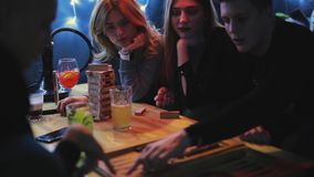 Friends plays backgammon in bar stock video