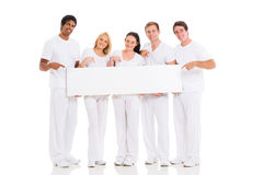 Friends pointing blank white board Royalty Free Stock Images