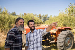 Friends pointing at distance in farm. On a sunny day Stock Image