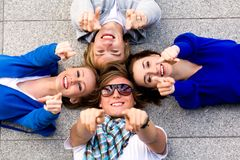 Friends pointing their fingers Royalty Free Stock Image