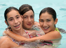 Friends in a pool Royalty Free Stock Image