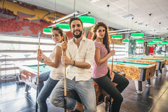 Friends at pool table stock image