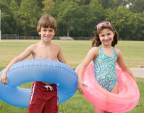 Friends at the Pool With Their Inner Tubes. Friends Together at the Pool With Their Inner Tubes stock images