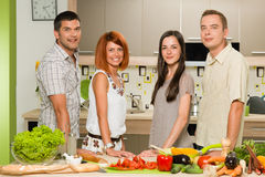 Friends posing while cooking Stock Photography