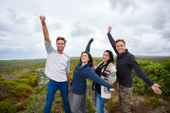 Friends posing excitedly in nature together Stock Image