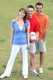 Friends posing with a football Stock Images