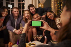 Friends Posing For Photo As They Have Fun At Party Together Stock Photo