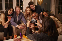 Friends Posing For Photo As They Have Fun At Party Together Royalty Free Stock Image