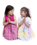 Friends praying. Two young girls kneeling and sharing a prayer royalty free stock photos