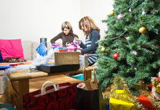 Friends Preparing Christmas Presents Stock Photography