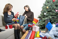 Friends Preparing Christmas Presents Royalty Free Stock Photography