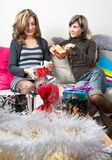 Friends Preparing Christmas Presents Stock Image