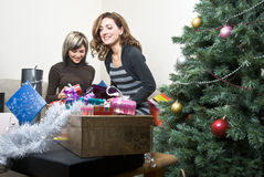 Friends Preparing Christmas Presents Royalty Free Stock Image