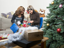 Friends Preparing Christmas Presents Royalty Free Stock Photos