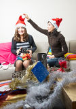 Friends Preparing Christmas Presents Stock Photos
