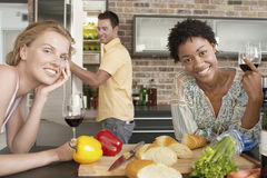 Friends Preparing Dinner Together Stock Images