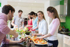 Friends Preparing A Meal Royalty Free Stock Photos
