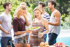 Friends preparing for outdoors barbecue party Royalty Free Stock Photography