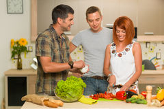 Friends preparing a salad Stock Photography