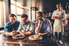 Friends in pub Royalty Free Stock Images
