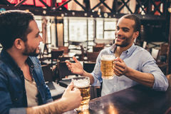 Friends in pub Royalty Free Stock Image