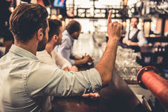 Friends in pub Royalty Free Stock Photos