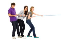 Friends pulling a rope. Group of young people pulling a rope Royalty Free Stock Image
