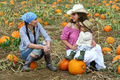 Friends in a Pumpkin Patch Royalty Free Stock Photo