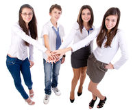 Friends putting hands together Royalty Free Stock Photos