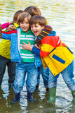 Friends in rain gear Royalty Free Stock Image