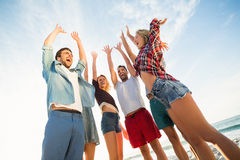 Friends raising their arms Royalty Free Stock Image