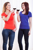 Friends raising their glasses Stock Image