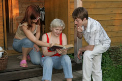 Friends read the book Royalty Free Stock Photo