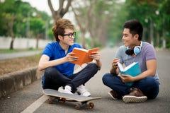 Friends reading Stock Photos