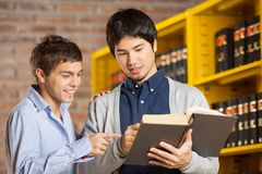 Friends Reading Book In College Library Royalty Free Stock Photo