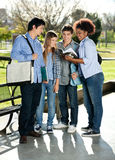 Friends Reading Book Together In College Campus Royalty Free Stock Photo