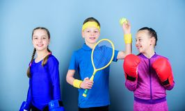 Friends ready for sport training. Child might excel completely different sport. Sporty siblings. Girls kids with boxing. Sport equipment and boy tennis player stock photography