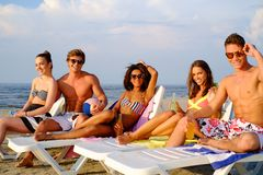 Friends relaxing on a beach Royalty Free Stock Photos