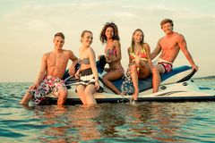 Friends relaxing on a beach Royalty Free Stock Image