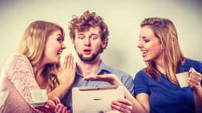 Friends relaxing browsing internet on tablet. Stock Image