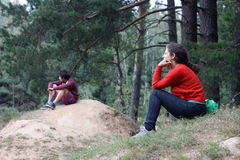 Friends relaxing in forest Royalty Free Stock Photo