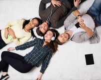 Friends relaxing  with gadgets Royalty Free Stock Photo