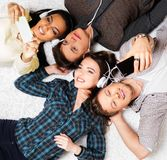 Friends relaxing  with gadgets Stock Photos