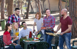 Friends relaxing at grill party Stock Image