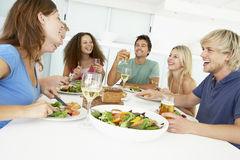 Friends Relaxing At Home Having Lunch Royalty Free Stock Images