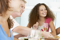 Friends Relaxing At Home Having Lunch Stock Photos